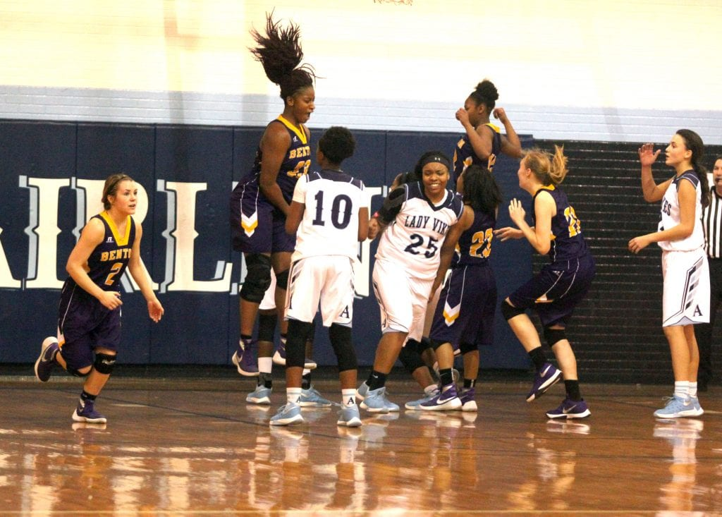 Russell Hedges/Press-Tribune Benton and Airline players react after Lazaria Lloyd's putback as time expired gave the Lady Tigers a 44-43 victory in the quarterfinals of the Doc Edwards Invitational Monday at Airline.