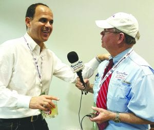Tom Pace (right) interviews Camping World CEO Marcus Lemonis prior to the 2015 Independence Bowl in Shreveport.