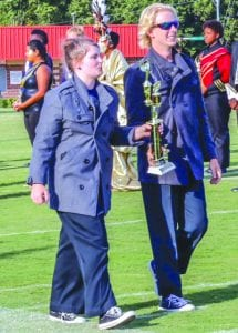 Courtesy Photo | Drum Captain Erin Bullock and Drum Lieutenant Ben Brandao getting 4 States Outstanding Percussion Award.
