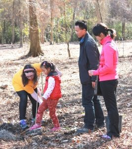Eight-year-old Tessa Gordon, of Baton Rouge, left, helps her friend Ze-Xuan MA plant a tree during the Arbor Day celebration at the LSU AgCenter Botanic Gardens at Burden in Baton Rouge in 2014. Ze-Xuan is the daughter of Chang-Le MA and Jing Li of China, right.