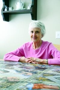 "Amanda Simmons/Press-Tribune | Elizabeth Curran of Bossier City has completed a 5,000 piece Ravensburger puzzle and is now looking for someone to take it and display its ""artistic beauty"" for the public."