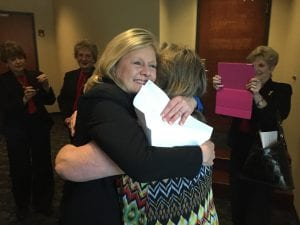 Photo by Amanda Simmons/Press-Tribune | Stephanie Agee hugs Bossier Clerk of Court Cindy Johnston following the police jury's vote to name her the registrar of voters.