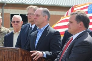 Bruce Franklin/Press-Herald |  Louisiana Gov. John Bel Edwards, center, along with Minden Mayor Tommy Davis, State Rep Gene Reynolds and Sen. Ryan Gatti, gives an update on the M6 destruction at Camp Minden Friday. Edwards said the burn is expected to start this week.