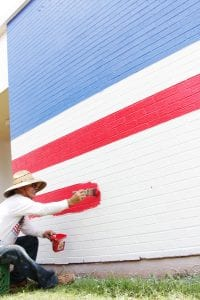 Chris Opp painting the stripes.