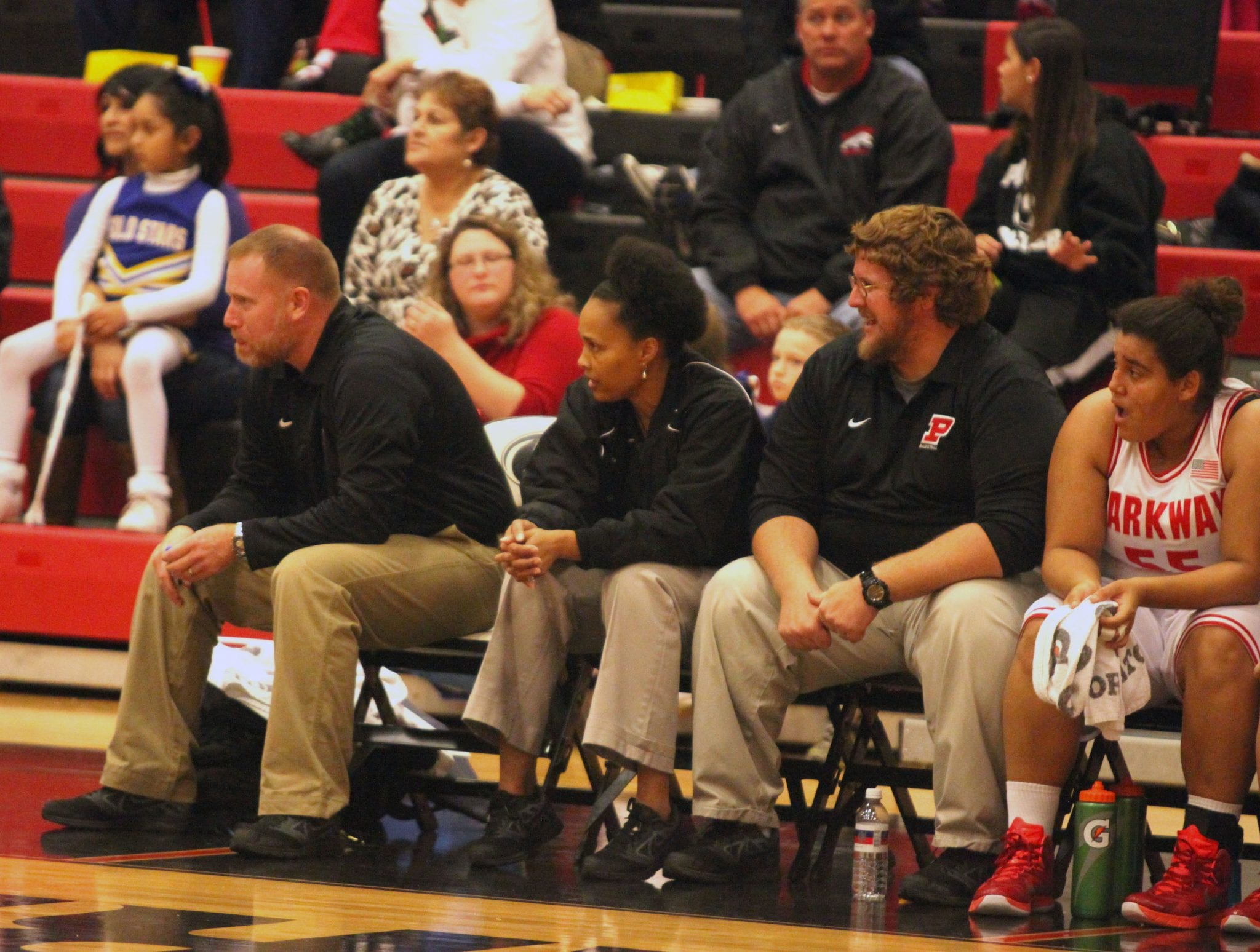 Russell Hedges/Press-Tribune New Parkway head girls basketball coach Gloria Williams, then an assistant coach, sits between former head coach Aaron Megee and assistant Kent Falting during a game in the 2014-15 season.