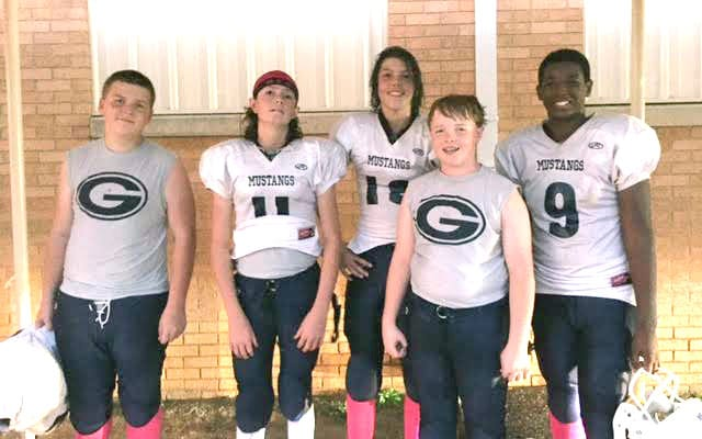 Submitted photo Greenacres players (left to right) Ashton Prins, Carson Carey, Gavin Ashworth, Caleb Hemmings and Jyson Thomas pose for a photo after the Mustangs' seventh-grade victory over Benton Tuesday. Greenacres is in a three-way tie for first.