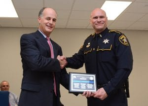 Class President Greg Brown presents a special plaque to Sheriff Julian Whittington.