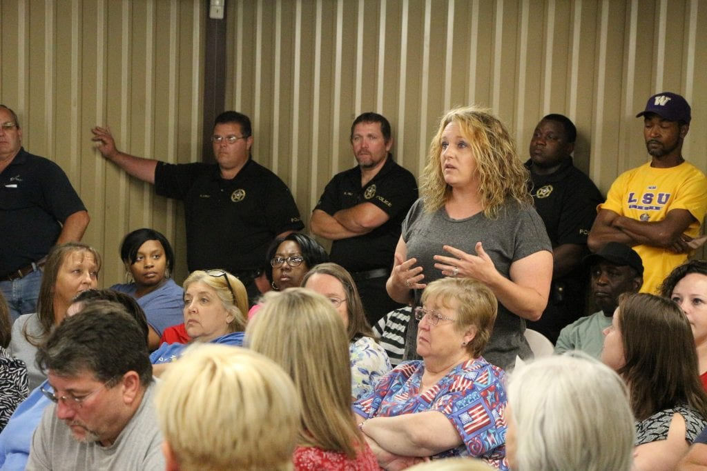 Plain Dealing resident Stephanie Gafford asks a question during the town hall meeting last week. Gafford has two children enrolled in Plain Dealing schools and is fighting to keep their schools open and on separate campuses.
