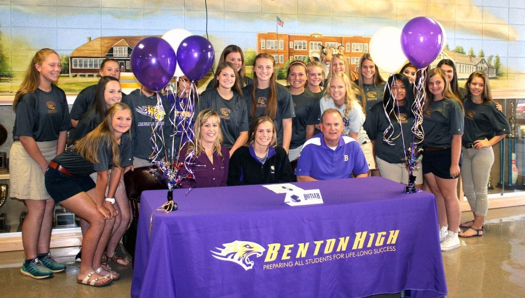 Russell Hedges/Press-Tribune Benton All-Parish softball player Abi Cole is surrounded by her family and teammates during a signing ceremony Tuesday morning. Cole signed with Butler (Kansas) Community College.