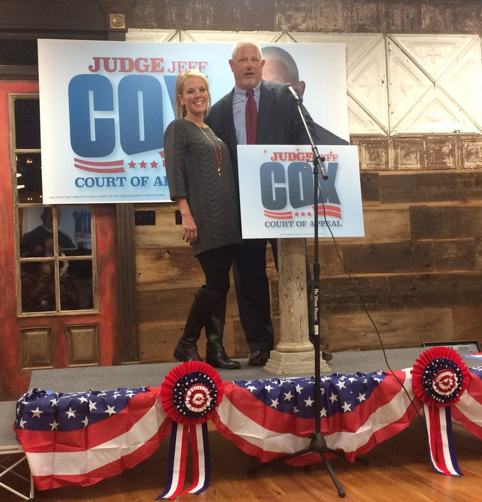 Judge Jeff Cox and his wife, Susan, address their supporters after his victory in the 2nd Circuit Court of Appeals race Tuesday night.