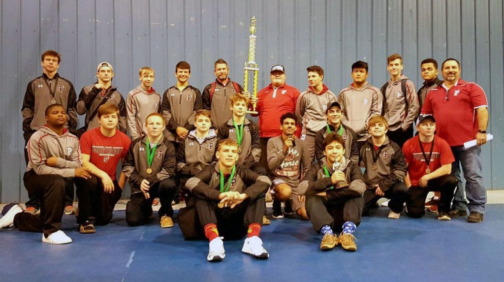 Courtesy Photo The Parkway Panthers pose with the trophy after winning the Evangel Holiday Classic on Thursday.