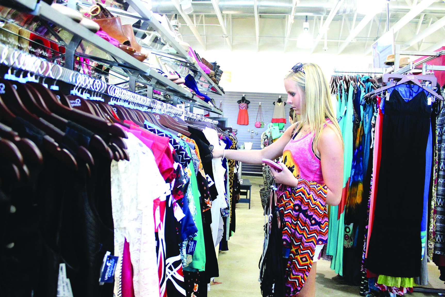 f312d30e649e Bossier City resident Anna McGaha browses through the racks of clothes at  the recently opened Uptown Cheapskate, a newly opened store that is making  hot ...